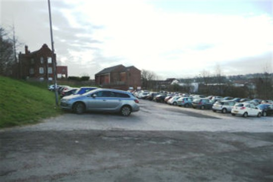 car park at 6 Ashgate Road with buildings in background